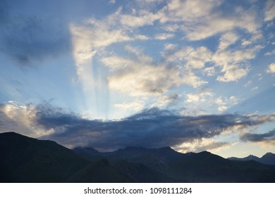 Georgia, Caucasus: impressive sky with sunbeams through the clouds