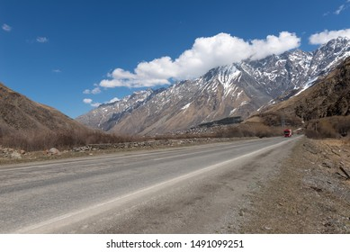 Georgia (Country) road with a truck in the mountains to the Russian border