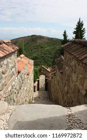 Georgia, Signagi (Sighnaghi). 08.28.2015. Down the stairs in the fortress on either side of the stone walls with orange tiles.