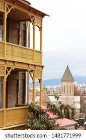 Georgia, Tbilisi - March 2019: Old houses in historical part of Tbilisi. Shabby house with window and balcony in old Tbilisi, Georgia