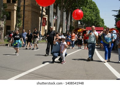 GEORGIA, TBILISI - MAY 26, 2019: Feast in Tbilisi. Independence Day. Theatrical  performance on the streets of Tbilisi. Happy and laughing people