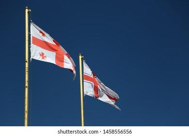 in georgia the waving blurred flag in the sky