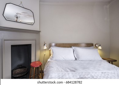 Georgian bedroom detail with fireplace and accessories