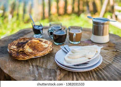 Georgian breakfast pancakes jam suluguni and coffee