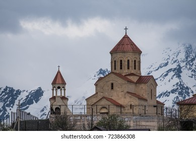 Georgian church with snowy mountains on the background in Mestia, Georgia