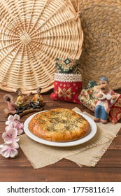 Georgian khachapuri with cheese and spinach / potatoes / beans / meat on a wooden background. Georgian snack. Georgian cuisine.