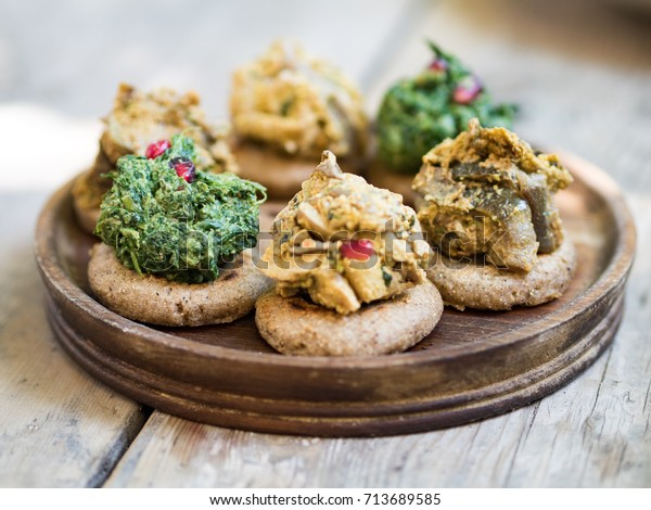 Georgian Starter with Spinach and Walnuts on a Wooden Dish in Tbilisi, Georgia