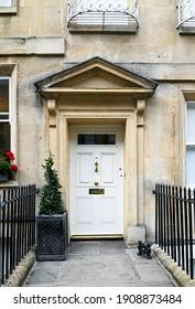 Georgian style white door and surrounding architecture, UK