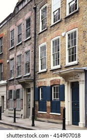 Georgian terraced town houses in Spitafields in the East End of London, England, UK, which where the homes of wealthy Huguenot silk merchants escaping religious persecution in France