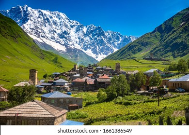 Georgian Village Ushguli with stone defense towers in a valley next to the river in Svaneti region near Mestia in Caucasus mountains in Georgia.