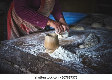 Georgian woman makes traditional bread in the rural kitchen in Kakheti village, Georgia
