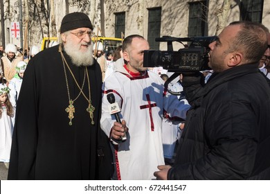 Georgia-Tbilisi.The priest gives an interview to the first channel in the center of Tbilisi.1/7/2017.