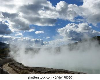 Geothermal Cloud factory - steaming geyser pool in Rotorua