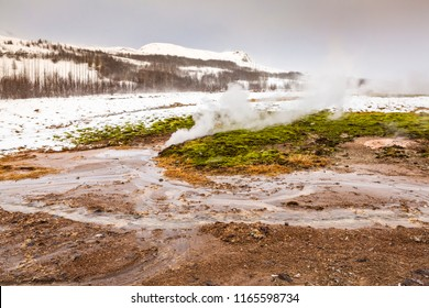 Geothermal landscape Strokkur Geysir in Winter. Located on the Golden circle, Geyir is a popular attraction for tourists.