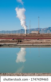 Geothermal power field with mountains in the background and reflex of the vapor on the water, CERRO PRIETO geothermal plant, Mexicali, Baja California, MEXICO
