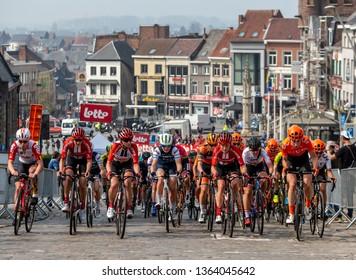 Geraardsbergen, Belgium - April 7, 2019 : The feminine peloton   riding on a cobblestone road in Geraardsbergen during Women Tour of Flanders 2019. Marta won this edition of the race.