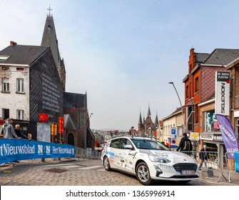 Geraardsbergen, Belgium - April 7, 2019 : The technical car driving on the cobblestone road in Geraardsbergen during Tour of Flanders 2019.
