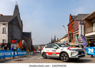Geraardsbergen, Belgium - April 7, 2019 : The technical car of UAE Team Emirates driving on the cobblestone road in Geraardsbergen during Tour of Flanders 2019.