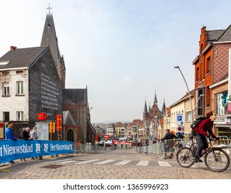 Geraardsbergen, Belgium - April 7, 2019 : Spectators are wiating for the cyclists on the side of the cobblestone road in Geraardsbergen during Tour of Flanders 2019.