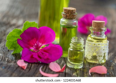 geranium essential oil container on wooden