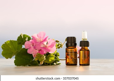 Geranium essential oils in bottles