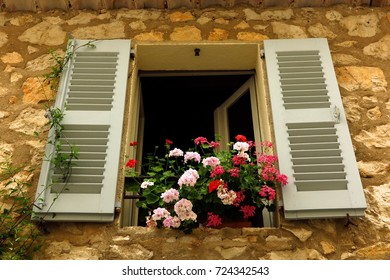 geraniums in window flower box in medieval village of Gourdon, Provence, France