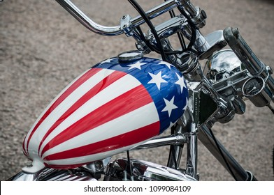 Gerarmer - France -26 May 2018 - closeup of motorbike tank with american flag painting on Harley Davidson motorbike parked in the street