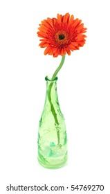 Gerbera flower in green bottle, isolated on white