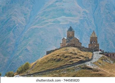 Gergeti christian church near Kazbegi, Stepancminda village in Georgia, Caucasus.