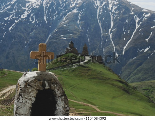 Gergeti Trinity Church beautiful view to pass and mountains peaks