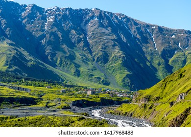 Gergeti Village on the background of the high Caucasus Mountains in Georgia