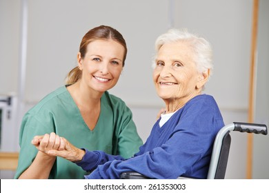 Geriatric care with nurse and happy senior woman in a wheelchair