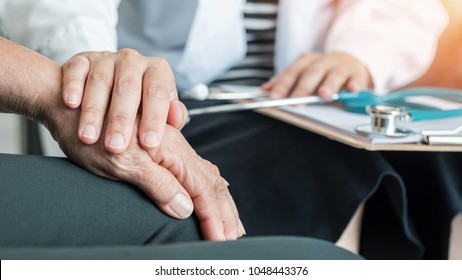 Geriatric doctor consulting and diagnostic examining elderly senior adult patient on ageing, Parkinson's disease, Arthritis hand and knee pain and mental health care in medical exam clinic or hospital