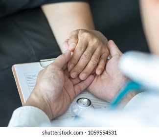 Geriatric doctor consulting and diagnostic examining elderly senior adult patient on aging, Parkinson's disease, Arthritis hand pain and mental health care in medical exam clinic or hospital