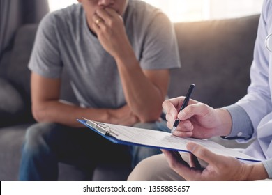 Geriatric doctor or geriatrician concept, Doctor visiting with patient in room and hearing serious disease diagnose writing on clipboard while consulting a man at home