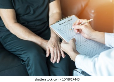 Geriatric doctor (geriatrician) consulting and diagnostic examining elderly senior adult patient (older person) on aging and mental health care in medical clinic office or hospital examination room