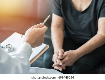 Geriatric doctor (geriatrician) diagnostic examining elderly senior or woman adult patient (older person) on aging and mental health care in medical clinic office or hospital examination room