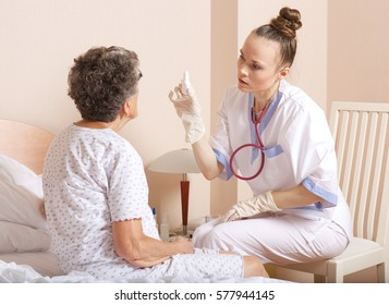Geriatrician visits a senior woman between 70 and 80 years old in her ward