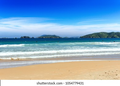 GERIBA BEACH, BUZIOS, RIO DE JANEIRO, BRAZIL: Panoramic view of the Geriba Beach in a sunny day. Blue sea with waves and golden sands. Islands at background. Tourist destination in latin america.