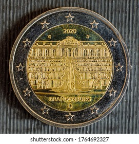 German 2 Euros coin from 2020, obverse showing the Brandenburg Gate. Isolated on black background