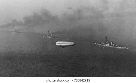 German battlecruisers steam toward Scapa Flow, in the Orkney Islands, Scotland, Nov.-Dec. 1918. In this photo taken from a British airship, ships steaming toward their Post-WW1 internment, L-R: SMS MO