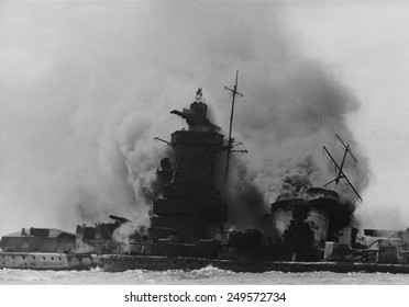 The German battleship 'Admiral Graf Spee', burning off Montevideo, Uruguay, Dec. 19, 1939. After the 'Battle of the River Plate' with three British cruisers, Graf Spee retreated to Montevideo harbor.