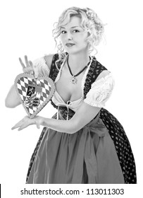 german bavarian girl in typical oktoberfest dress with traditionally cookie. black and white