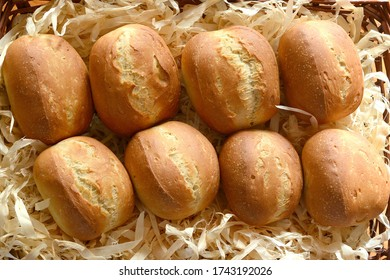 German breakfast bread buns, called Broetchen, freshly baked and ready to eat.
