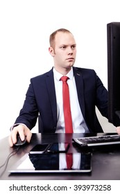 German businessman working in the workplace computer. Phone, tablet, mouse, keyboard. Isolated on white background.