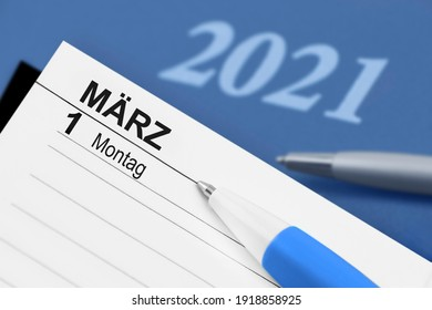 German calendar March 1 2021 and blue background