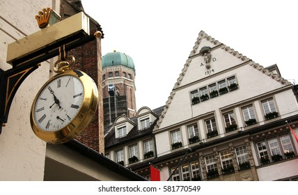 German center city, clock and tower, Munich, old school buildings