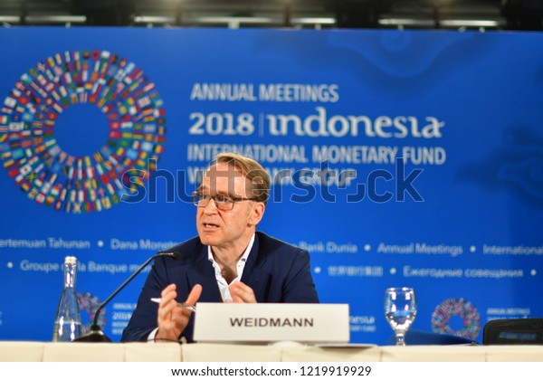German central bank chief Jens Weidmann speaking at press conf. at the 2018 annual meetings of the IMF/World Bank held on Bali in Indonesia