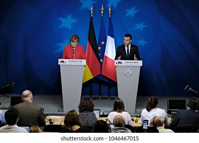German Chancellor Angela Merkel, left, and French President Emmanuel Macron address the media at an EU summit in Brussels,Belgium on June 23, 2017.