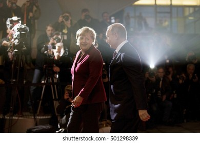 German Chancellor Merkel and Russian President Putin meet at the Chancellery prior to a meeting with French President Hollande and Ukrainian President Poroshenko in Berlin on October 19, 2016.
